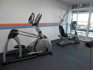 Elliptical machine in fitness room
